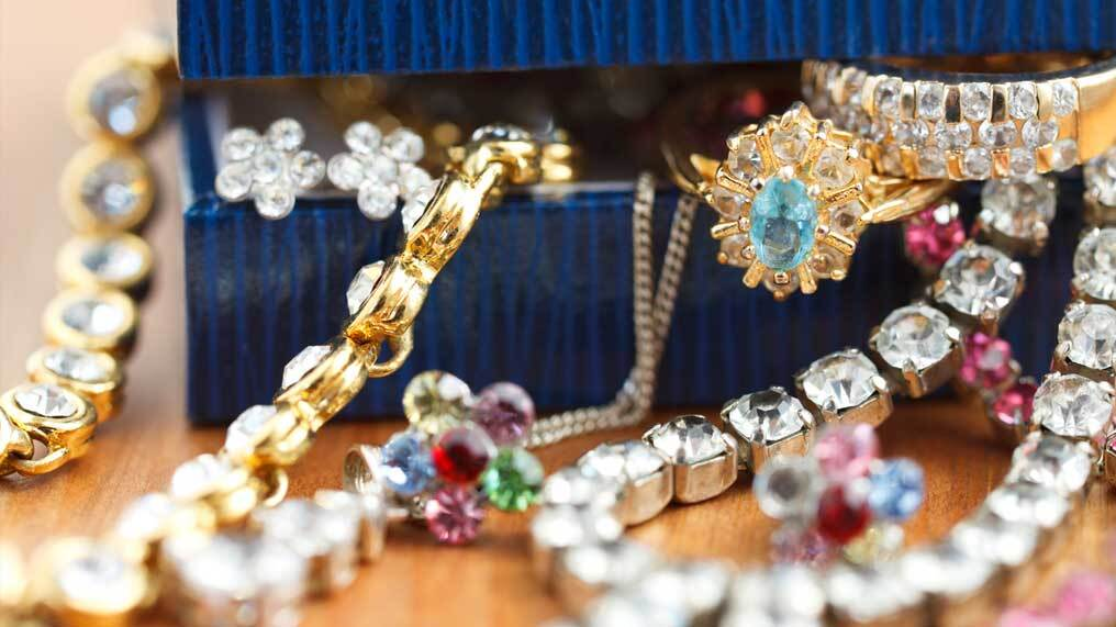 A selection of jewellery is seen coming out of a jewellery box.