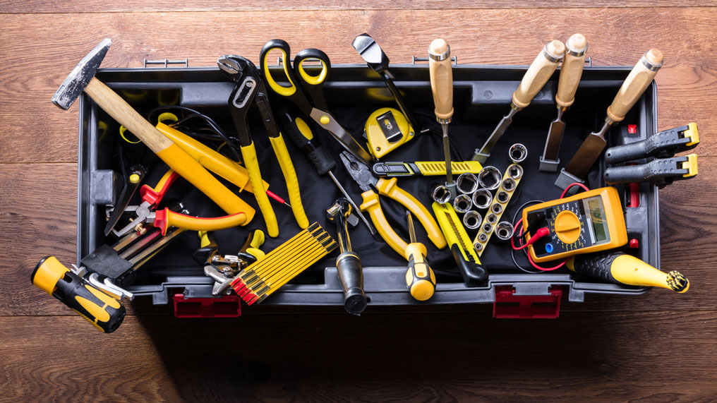 A toolbox with its contents spilling out.